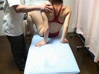 Girl In Red Swimsuit Gets Massage